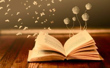 Open book with flowers and butterflies leaping from the pages